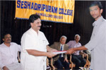 Presenting letter of offer of placement to a student of Seshadripuram College as Hon. General Secretary of Seshadripuram Educational Trust.  Principal Dr. Narahalli Balasubramanya looks on