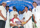 Kannada Chaluvali Leaders Sri Vatal Nagaraj and Sri Sa. Ra. Govindu felicitating Dr. Wooday P. Krishna on 13-7-2015, Bengaluru, under the auspices of Kannada Rakshana Samiti.