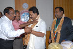 Dr. T. Ananthpadmanabha and Er. A. S. Satish, Council Members, IEI felicitating Dr. Wooday P. Krishna,Chairman, IEI, Karnataka State Centre, in the presence of Er. Ashok Kumar Basa, President, IEI, on 1-2-2014.
