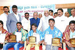 Educationist Dr. Wooday P. Krishna, Supreme Court Judge Hon�ble Justice V. Gopala Gowda and Former Judge of Karnataka High Court Justice Nagamohandas presenting scholarships to highly meritorious Kannada students at the function organized by Kannada Kriya Samithi, Bengaluru, on 14-8-2016.
