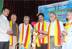 At Kannada Rajyotsava function organised by Seshadripuram Main Pre-University College along with noted literary personalities Dr. Narahalli Balasubramanya, Dr. Siddalingaiah, Dr. P. V. Narayana and Dr. Dodda Rangegowda.