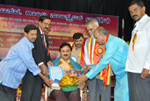 Being felicitated by Prof. Mallepuram G. Venkatgesh, Vice-Chancellor, Karnataka Sanskrit University at a function organized by Buddha, Basava, Gandhi Cultural Trust.