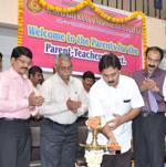 Inaugurating a Parent-Teachers Meeting at Seshadripuram Composite Pre-University College, Bengaluru, 2012.