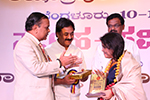 Noted Singer Sangeetha Katti being felicitated by Educationist Dr. Wooday P. Krishna and Justice Dr. N. Kumar, 2016.