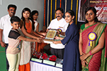 Educationist Dr. Wooday P. Krishna felicitating academic achievers on the occasion of annual day celebration of Seshadripuram Main Pre-University College, 2016. Also seen are Shri S. Viswanath and Smt. Shobha S.