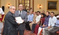 Dr. Wooday P. Krishna, Member, Central Committee, the Tuberculosis Association of India  (sitting 4th from right) at the TB Seals Campaign function held at Rashtrapati Bhavan, New Delhi on  2-10-2015.  Dr. S. P. Agarwal, President, TAI, receiving the TB Seals from Rashtrapati Pranab Kumar Mukherjee.