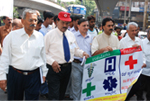 Participating in a Walkathon to create awareness on misuse of Red Cross Emblem.