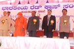 At the inauguration of Red Cross Bhavan in Tumkur along with Shri H. R. Bharadwaj, Governor of Karnataka, Revered Dr. Sri Sri Sri Shivakumar Mahaswamiji of Siddaganga Math and Dr. C. Somasekher, Deputy Commissioner, Tumkur.