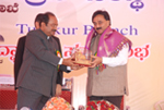 Being felicitated by Dr. C. Somasekher, Deputy Commissioner, Tumkur.
